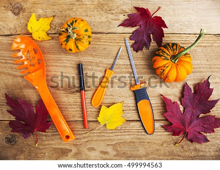 Pumpkin instruments with leaves and pumpkins on wooden table