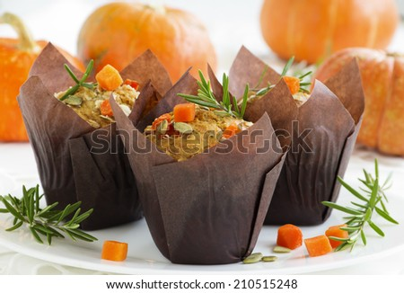 Pumpkin muffins with rosemary and seeds. - stock photo