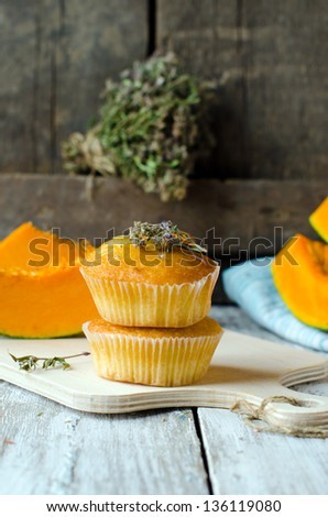 Pumpkin muffins with thyme, selective focus - stock photo