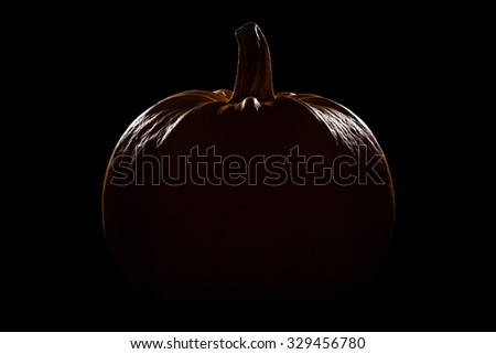 Pumpkin on black background - stock photo