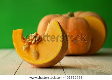 Pumpkin on green background - stock photo