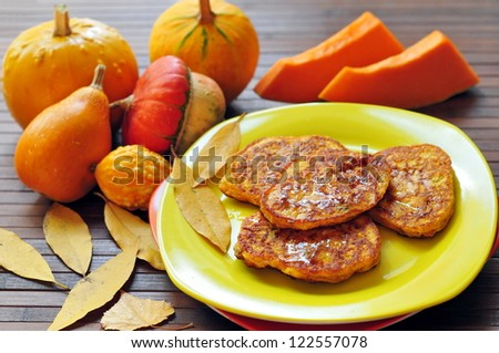 Pumpkin pancakes with honey - stock photo