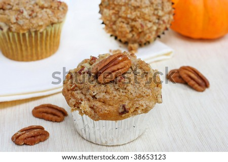 Pumpkin pecan muffins with streusel topping.