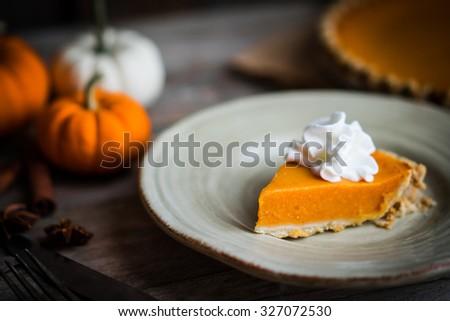 Pumpkin pie on rustic wooden background - stock photo
