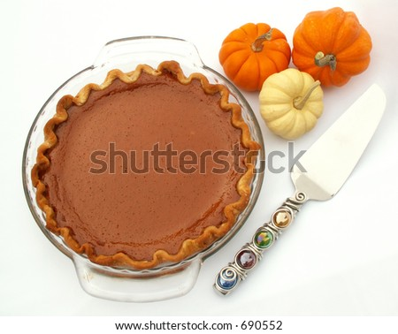 pumpkin pie with pie server and mini pumpkins - stock photo