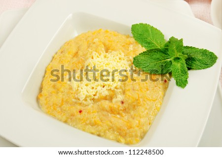 Pumpkin porridge with mint leaf on the white dish