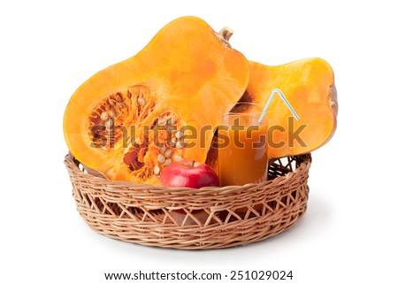 pumpkin, pumpkin juice and apple arranged in a basket isolated on white background - stock photo