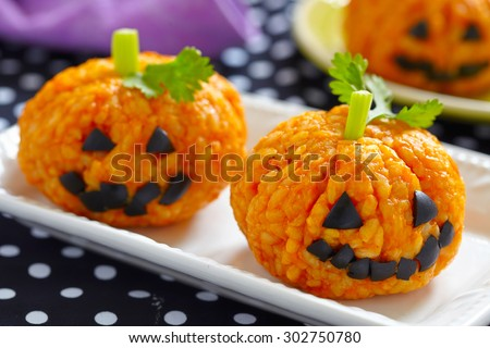 Pumpkin Rice Ball Jack O Lanterns for Halloween party - stock photo