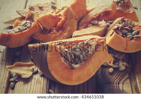 pumpkin seeds and  pieces pumpkin. Halloween - stock photo