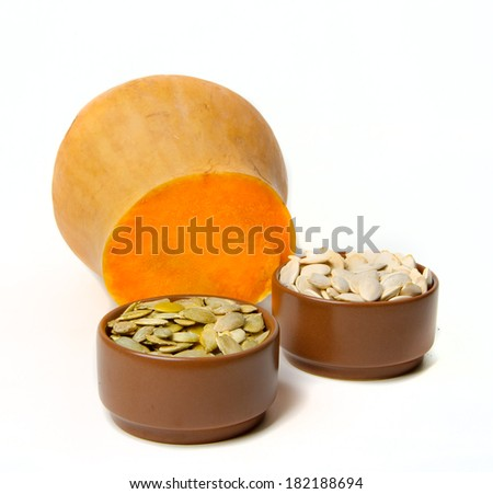pumpkin seeds and sliced on white background
