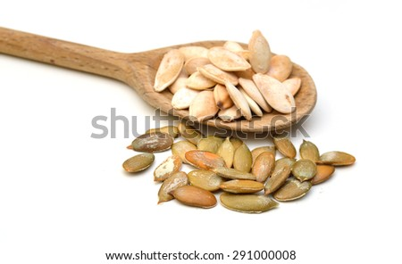 Pumpkin seeds isolated in wooden spoon on white background - stock photo
