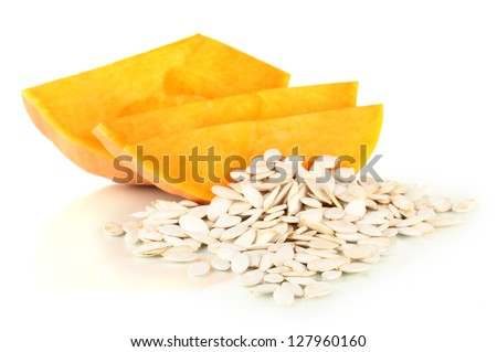 Pumpkin seeds isolated on the white - stock photo