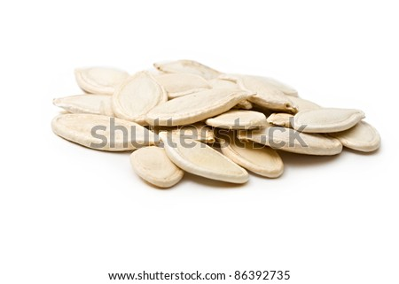 Pumpkin seeds isolated on the white background - stock photo