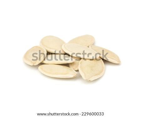 Pumpkin seeds isolated on white background close-up