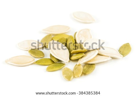 Pumpkin seeds on a white background.Seeds of white. - stock photo