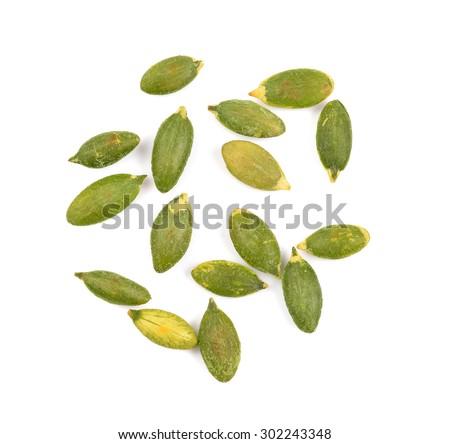 pumpkin seeds on white background - stock photo
