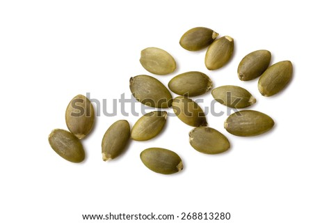 Pumpkin seeds or pepitas, isolated on white background.  Overhead view. - stock photo
