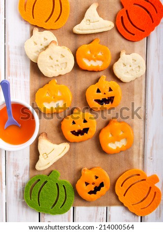 Pumpkin shape Halloween cookies with orange glaze