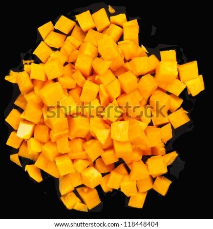 Pumpkin small blocks on black background - stock photo