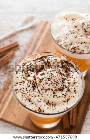 Pumpkin smoothie, spice latte with whipped cream on top