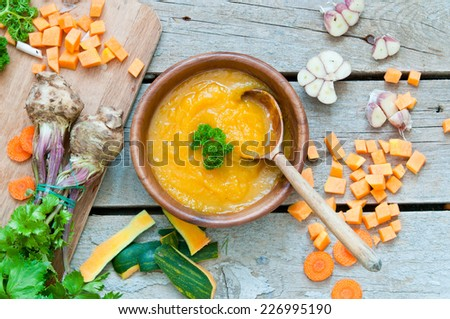 Pumpkin soup. Autumn dinner with healthy vegetable soup - stock photo