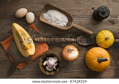 Pumpkin soup ingredients on wooden background close up