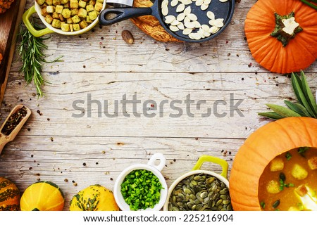 Pumpkin soup - Traditional seasonal pumpkin soup, space for text - stock photo