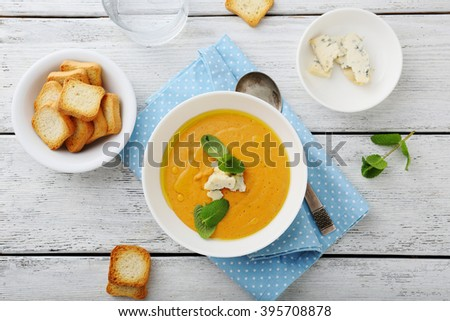pumpkin soup with blue cheese and croutons - stock photo
