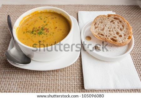 pumpkin soup with bread - stock photo