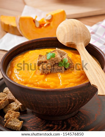 pumpkin soup with croutons - stock photo
