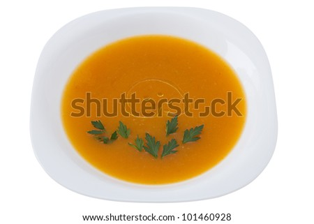 pumpkin soup with parsley in white plate