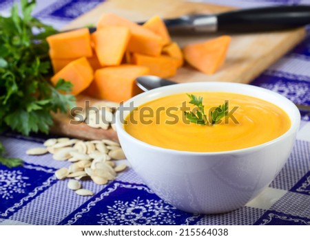 Pumpkin soup with parsley leaf - stock photo