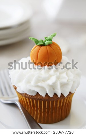 Pumpkin spice cupcake with vanilla frosting - stock photo