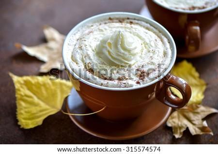 Pumpkin spice latte, traditional autumn warm cozy drink - stock photo