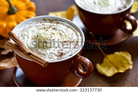 Pumpkin spice latte, traditional autumn warm cozy drink - stock photo