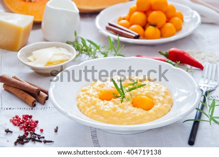 Pumpkin spicy risotto with pickled pumpkin in a white plate