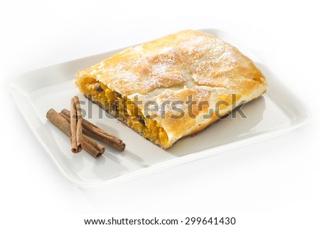 pumpkin strudel on a plate on a table with a cinnamon - stock photo