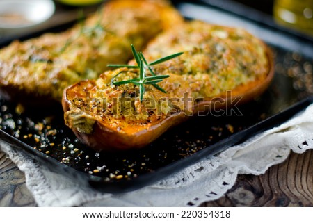Pumpkin stuffed with couscous, zucchini and cheese Dorblu - stock photo