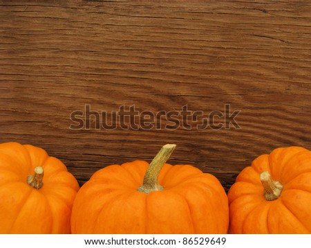 Pumpkin tops over a wooden background - stock photo
