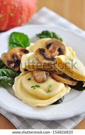 Pumpkin Tortellini with chard and mushrooms - stock photo