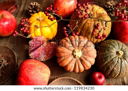 Pumpkin with apple.image of autumn and winter - stock photo