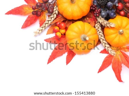 Pumpkins and colorful autumn decorations on white background. - stock photo