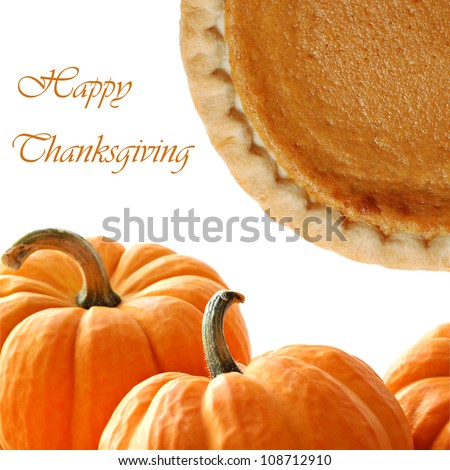 Pumpkins and freshly baked pumpkin pie on white background with copy space.