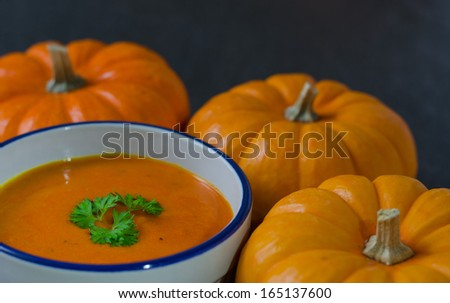 pumpkins and pureed soup - stock photo