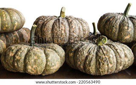 Pumpkins are plentiful stack on the table to put the rural market of Thailand. - stock photo