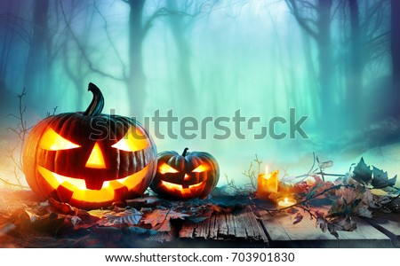 Pumpkins Burning In Forest At Night - Halloween Background