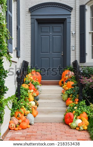 Pumpkins decorated Halloween ready front door - stock photo