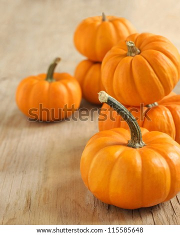 Pumpkins on a wooden table - stock photo