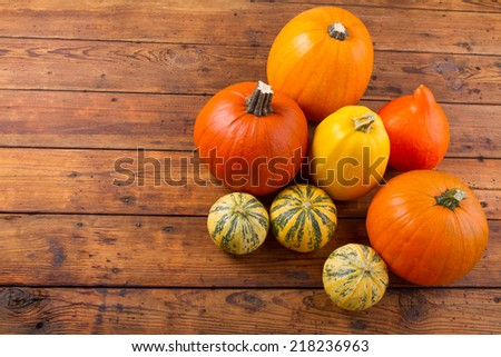 Pumpkins on the wooden table