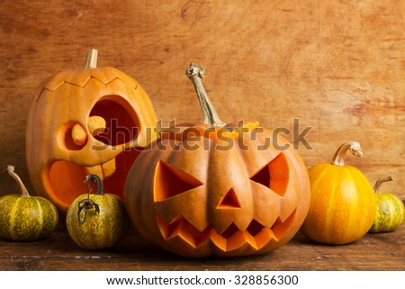 pumpkins on wooden background - stock photo